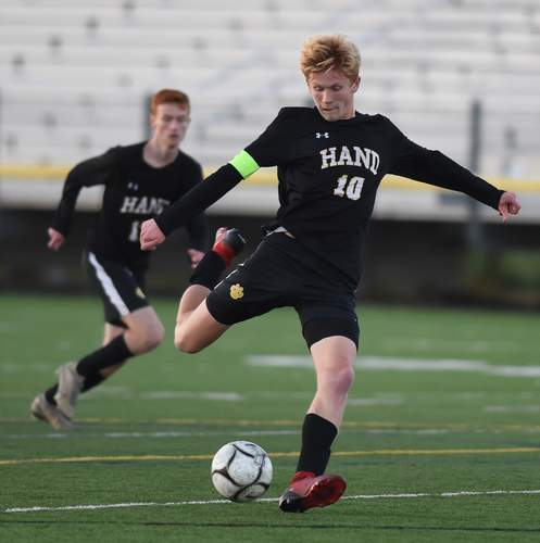 Senior captain Scott Testori netted a pair of goals to lift the Hand boys' soccer squad to a 2-0 home win over Guilford in its first game of the 2020 season on Oct. 2. Also pictured is fellow senior Jason Wallack. Photo by Kelley Fryer/The Source