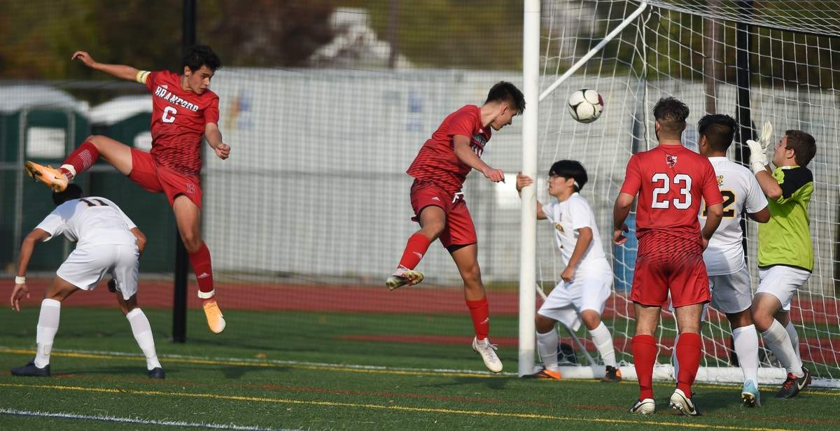 East Haven boys soccer lost 0-5 to Branford at Branford High School. Victor Calvillo (11), Kevin Phan  (2), Justin Carrillo (12), Asa Myers (GK)  Photo by Kelley Fryer/The Courier