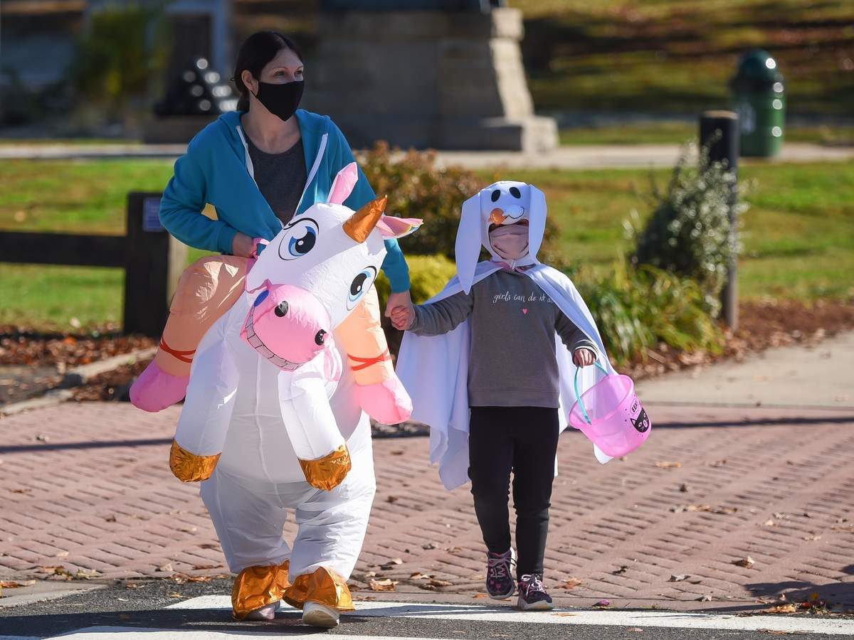 The Town of North HavenþÄôs Recreation Department hosted a Drive-Thru Halloween goody bag event in front of the Mildred Wakely Community Center Saturday from 11am - 2pm.  Nicole Riordan and Khalina Jalowiec are dressed and ready for Halloween and took a walk before heading back to the car for the drive thru goody bag event. Photo by Kelley Fryer/The Courier