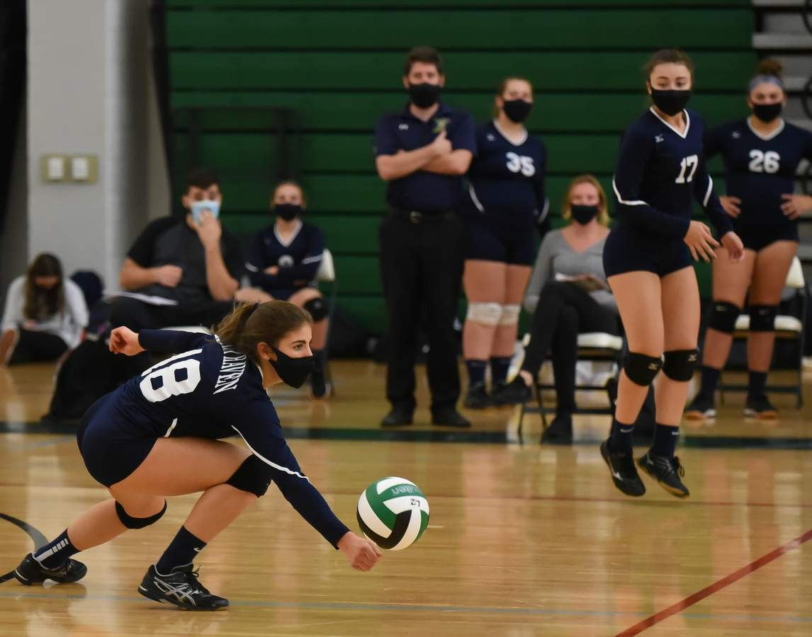 East Haven girls volleyball lost 0-3 to Guilford in the SCC Championship final at Guilford High School. Victoria Heaphy (18), Carly Cordova (17)  Photo by Kelley Fryer/The Courier