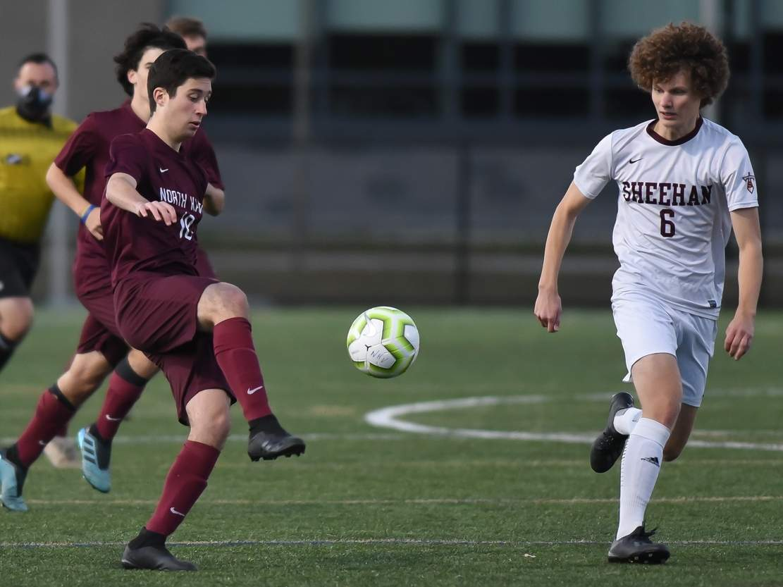Senior captain forward Eduardo Cienfuegos de Paz (left) had five goals and seven assists on his way to garnering All-SCC Division A accolades for the North Haven boys' soccer squad this fall. File photo by Kelley Fryer/The Courier