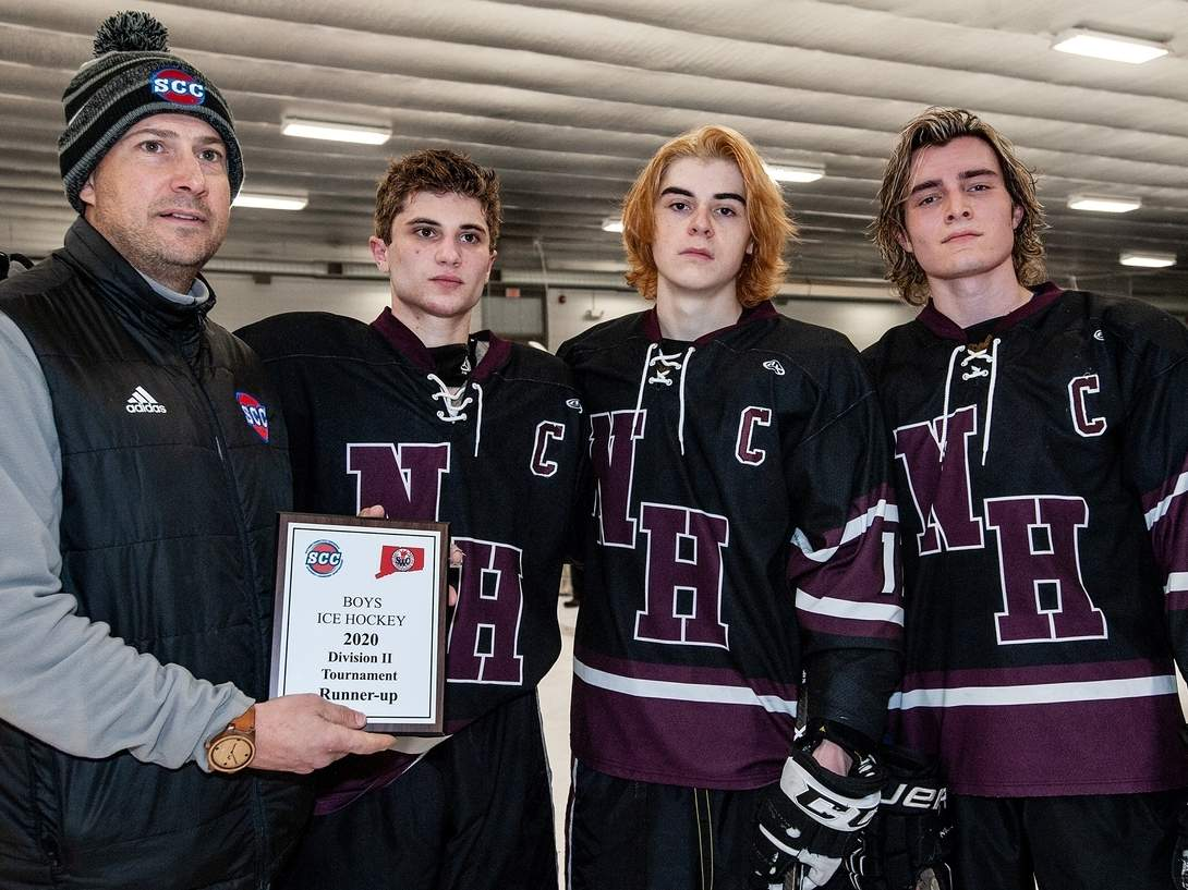 The North Haven boys' ice hockey squad notched 13 victories and advanced to its conference final this winter. North Haven was slated to play in the state quarterfinals, but the tournament was canceled as a result of the COVID-19 pandemic. Pictured with SCC Commissioner Al Carbone are senior captains Alan Tancreti III, Jake Wentworth, and Donny Funaro. File photo by Susan Lambert/The Courier