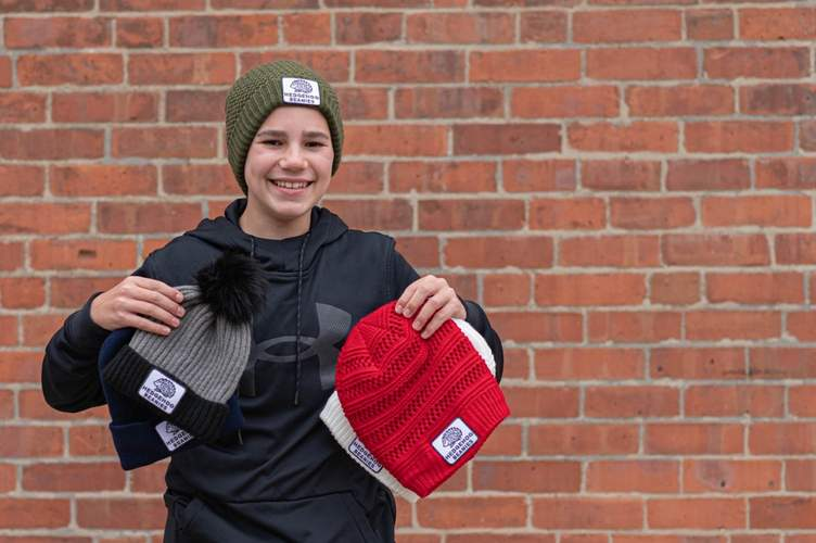 Cooper Schwartz is making a difference through his socially conscious company, Hedgehog Beanies, with each sale adding up to give another cozy cap, as well as warm socks and gloves, to homeless folks enduring New England's winter cold.  Photo courtesy of Cooper Schwartz