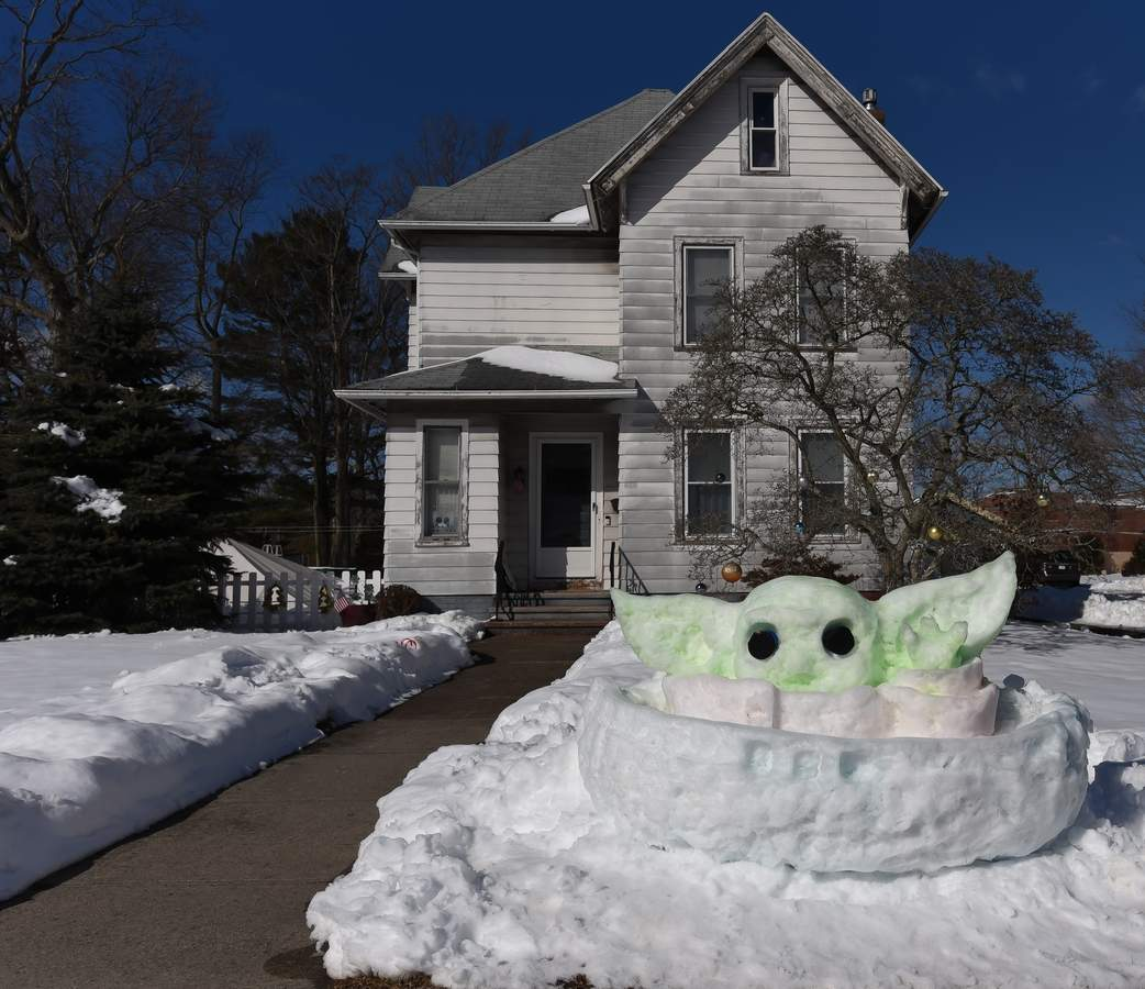 A snow Grogu sculpture was made on Thompson Ave, East Haven.   Photo by Kelley Fryer/The Courier