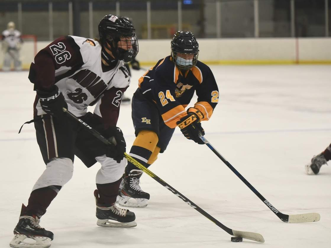Senior captain Eli Brubacher and the North Haven boys' ice hockey squad posted victories in their first two games of the winter season. North Haven earned a 3-0 win over the East Haven co-op and then edged out Lyman Hall by a 2-1 final during the opening week of play. Photo by Kelley Fryer/The Courier