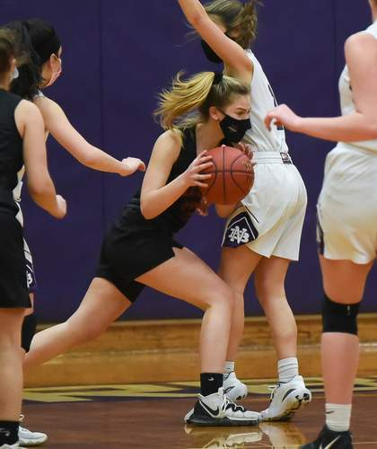 Sophomore Lily Grow scored eight points and corralled seven rebounds in the Warriors' win over North Branford on Feb. 10. Photo by Kelley Fryer/The Courier