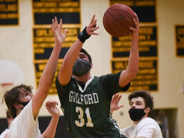 Senior Jackson Tandler and the Grizzlies claimed a 50-47 overtime victory against Cheshire on Feb. 16. File photo by Kelley Fryer/The Courier
