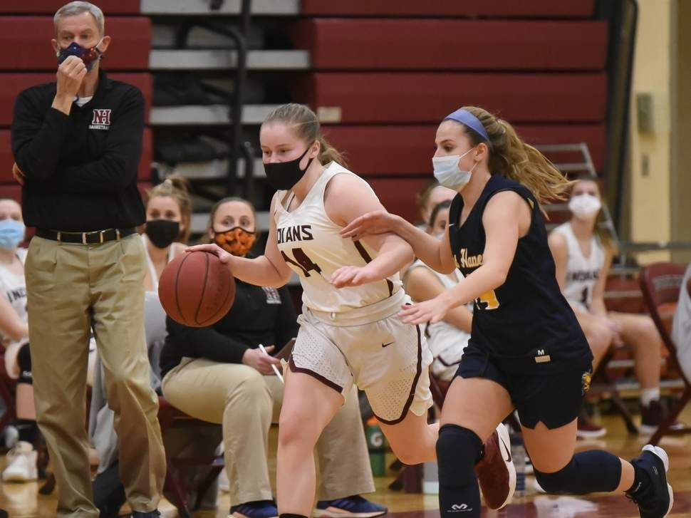 On Feb. 16, senior Carly Fresher and the North Haven girls' basketball team lost to Sheehan, but bounced back with a two-point win versus Amity later in the week.  File photo by Kelley Fryer/The Courier