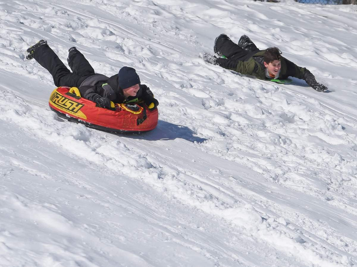 Fresh snowy powder brought out cousins Jon  Loffredo and Gavin Leone out to The Pit in East Haven sledding. Photo by Kelley Fryer/The Courier
