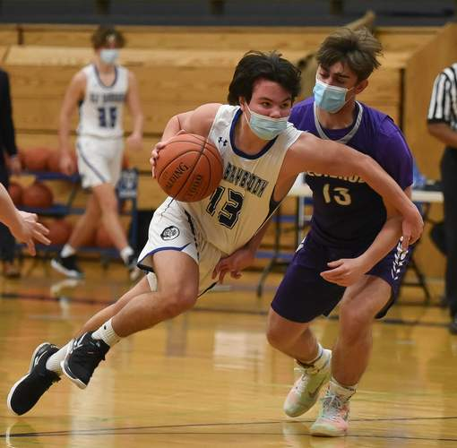 Junior captain Riley Lawson netted 20 points when the Old Saybrook boys' basketball team earned a 55-45 victory versus Coginchaug on Feb. 23.  File photo by Kelley Fryer/Harbor News