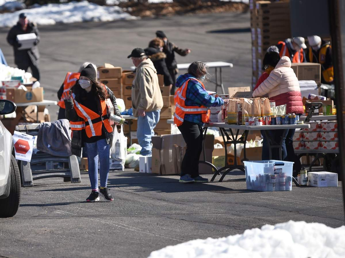 Members of the Old Saybrook Lions Club, the Valley Shore  YMCA, Old Saybrook Youth and Family Services with the help of the Connecticut Food Bank, Old Saybrook LionþÄôs Club, Valley Shore YMCA, Old Saybrook Social Services, Connecticut Dental Health Partnerships, came together in the parking lot of St. MarkþÄôs Church, Westbrook for Social Services Help Day volunteering for a Community-wide Food Distribution 10 a.m. to noon. Volunteers carried bags of food, toothbrushes, toothpaste, and dental supplies, and placed them in the cars as they drove up. Sydney Liggett greeted the cars as they approached.  Photo by Kelley Fryer/Harbor News