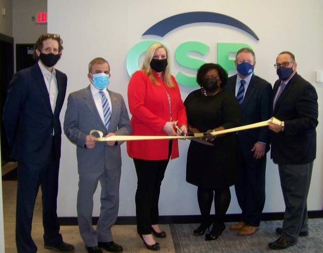 From left, New Haven Group Principal Steven Inglese; North Haven First Selectman Michael Freda; Guilford Savings Bank (GSB) Business Branch Manager Renee Miller, Vice President Shalonta Ford, and President & CEO Tim Geelan; and Quinnipiac Chamber of Commerce Senior Director of Sales & Marketing Gary Ciarleglio celebrate the ribbon cutting at GSB's North Haven branch.   Photo courtesy of the Quinnipiac Chamber of Commerce