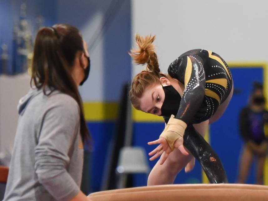 Junior Paige Dean claimed second place on the vault when the Hand gymnastics team competed against Law on March 12. The Tigers have been practicing and holding their meets at ABC Gymnastics in Niantic this year. Photo by Kelley Fryer/The Source