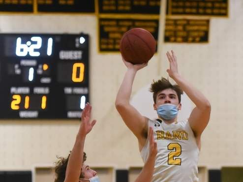 Senior Nick Donofrio and the Hand boys' basketball team improved to 6-4 on the year after winning four of their five matchups last week. File photo by Kelley Fryer/The Source
