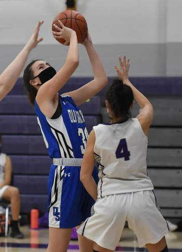 Junior Mackenna Cooke and the Rams took defeats versus Cromwell and East Hampton on last week's slate, after which their record stood at 2-8 on the year. Cooke led the Rams with nine points in their 58-33 home loss against Cromwell on March 8. File photo by Kelley Fryer/Harbor News