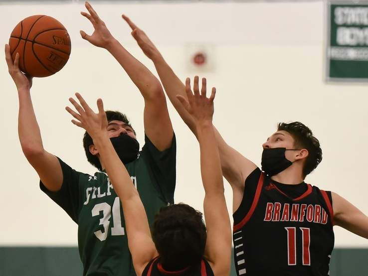 Senior Jackson Tandler and the Guilford boys' basketball team took a 53-46 defeat against Branford in the semifinals of the SCC Division II Tournament last week. Tandler scored eight points for the Grizzlies in the game. File photo by Kelley Fryer/The Courier
