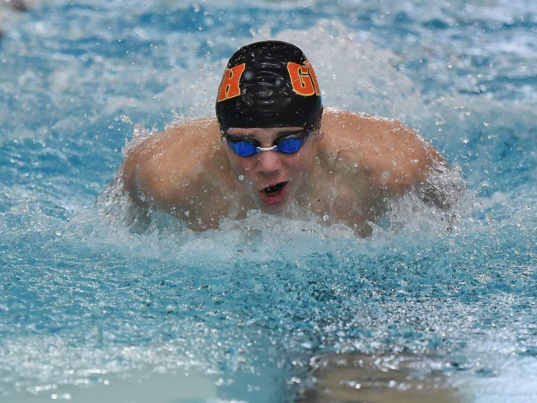 East Haven sophomore Brendan Conners won the 200 individual medley and the 100 backstroke to help the Greater New Haven Warriors earn a 94-92 victory versus Cheshire that clinched a share of the SCC Division I title for Head Coach Martha Phelan's squad.  Photo by Kelley Fryer/The Courier