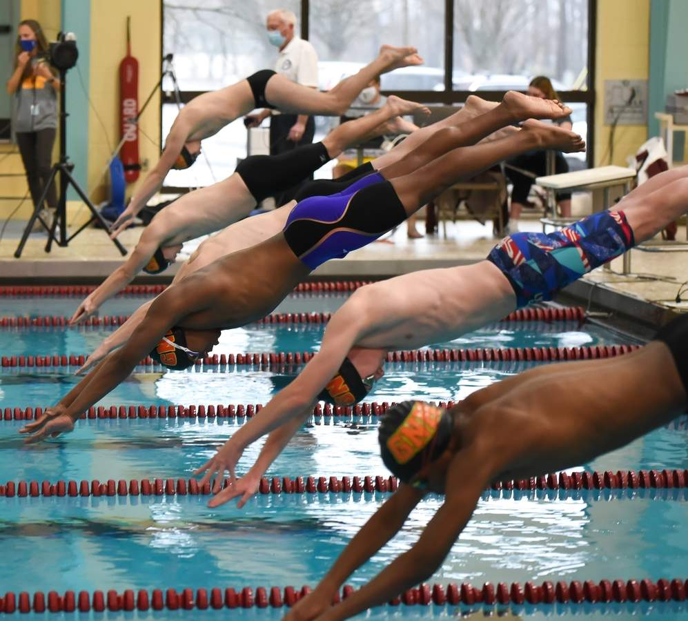 The start of 50 Free: Pavlo Melnyk, Tanner Powell, Cam Cargan, Hethon Foster, Aiden Cohen, Ray Lewis Photo by Kelley Fryer/The Courier