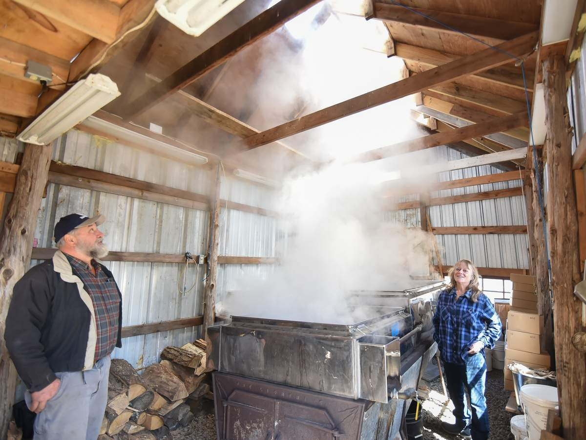 First day of spring at Maple Breeze Farm in Westbrook and the last day of making Maple Syrup for the year. Farmers John and Bonnie Hall watch as the steam rises from the massve evaporator and the surup thickens in the sugar house.  Photo by Kelley Fryer/Harbor News