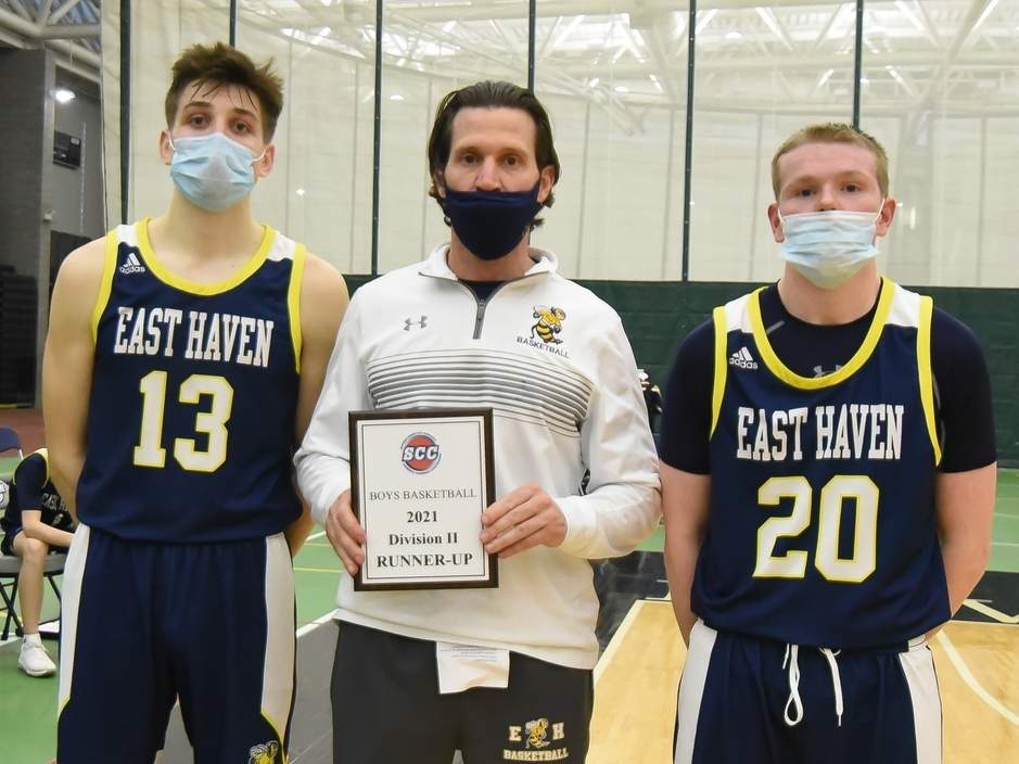 The East Haven boys' basketball team took a 34-26 defeat to Lyman Hall in the SCC Division II Tournament final at Floyd Little Athletic Center on March 26. Pictured for the Yellowjackets are senior captain Nick Furino, Head Coach Ricky Narracci, and senior captain Ian Reynolds. Photo by Kelley Fryer/The Courier