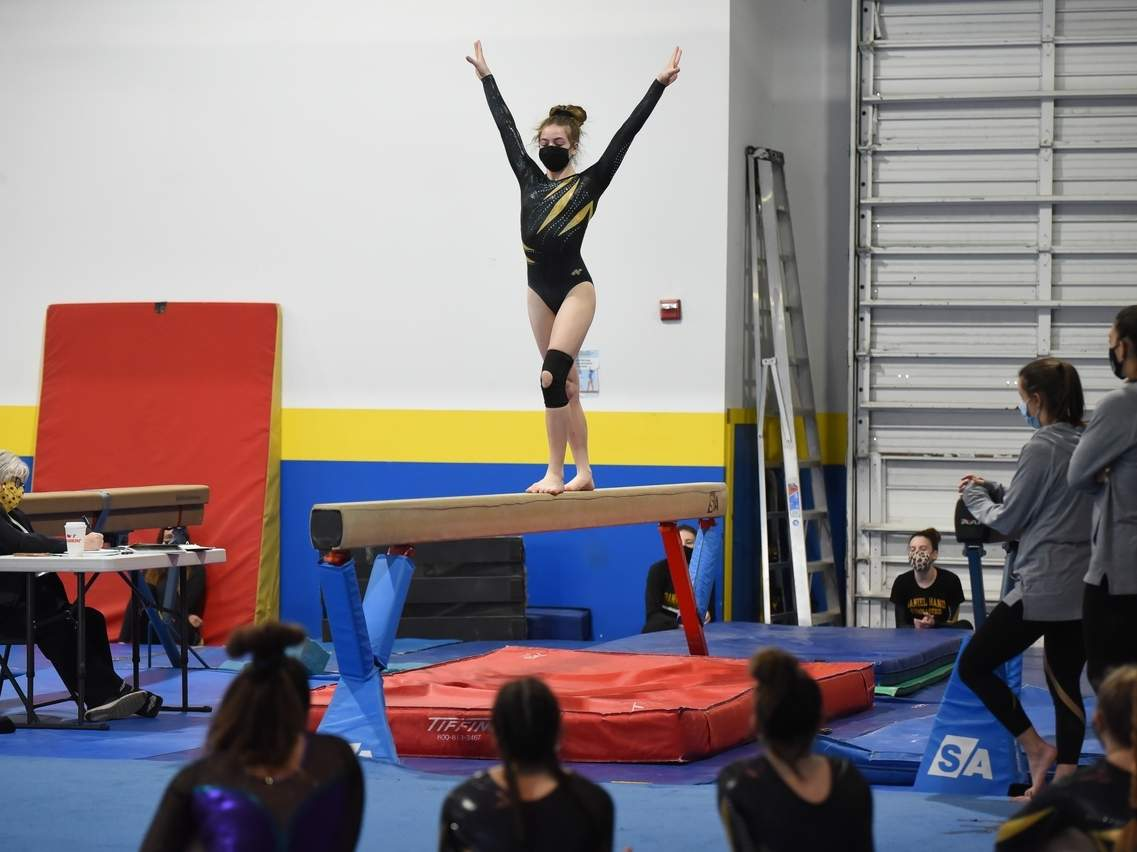 Freshman Hadley Reiss claimed third place in the all-around, including a first-place performance on the floor exercise, to help the Hand gymnastics team earn runner-up honors the SCC Virtual Championship meet. File photo by Kelley Fryer/The Source