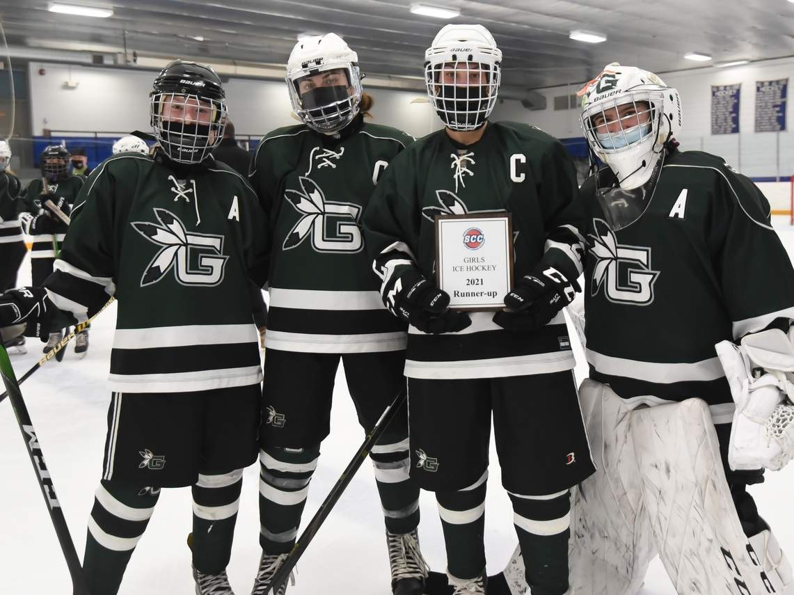The Guilford girls' ice hockey team came home with the SCC runner-up trophy after taking a 5-2 defeat versus West Haven-Sacred Heart Academy in the conference final at Bennett Rink on March 25. Pictured for the Grizzlies are senior alternate captain Christina Garofalo, junior captain Maddie Epke, junior captain Olivia Gill, and junior alternate captain Julia McDonald. Photo by Kelley Fryer/The Courier