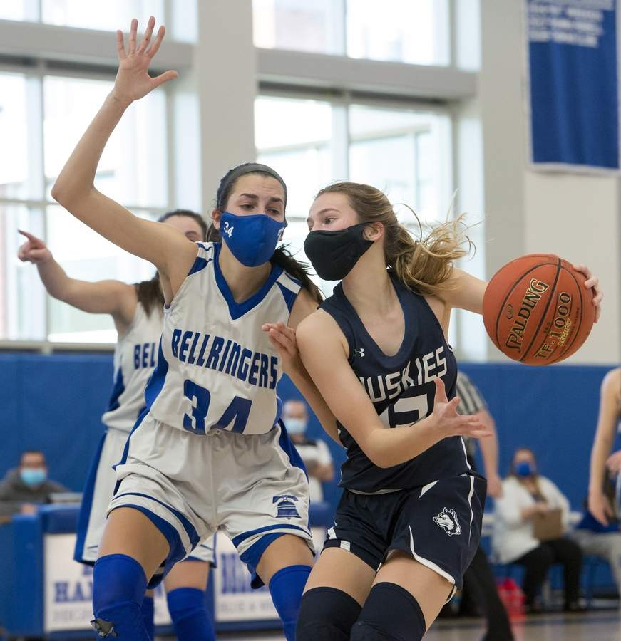 Morgan´s Catie Donadio (12) guarded by East Hampton´s Danielle Adams (34). Morgan was defeated by East Hampton in the Shoreline Conference Final 50-43 on Friday March 26, 2021. Wesley Bunnell / Harbor News