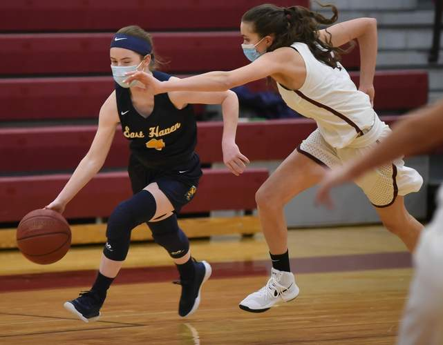 Senior captain Erin Curran earned All-SCC East Division accolades by virtue of her performance with the East Haven girls' basketball team this year. File photo by Kelley Fryer/The Courier