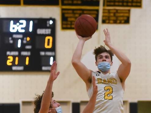 Senior captain Nick Donofrio and the Hand boys' basketball team persevered through adversity to win eight games and advance to the semifinals of the SCC Division II Tournament this winter. File photo by Kelley Fryer/The Source
