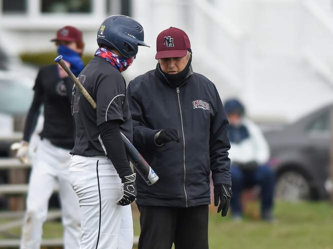 Head Coach Bob DeMayo and the North Haven baseball team played their first game in two years when the squad hosted Guilford for a Saturday matchup on April 10, winning the contest by an 8-3 score. Here, DeMayo talks shop with junior catcher Anthony Acampora during North Haven's scrimmage versus West Haven on April 1. Photo by Kelley Fryer/The Courier