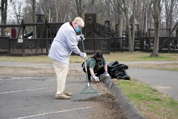 North Haven Lion Marie-Anne Barnhart rakes while helping to clean up Grover-Wyman Park on Saturday during Rid Litter Day along with North Haven High School Sophomore Katelyn Spader. The day focuses on one of the Lions five focus areas which are environment, hunger, vision, diabetes awareness and childhood cancer research. Wesley Bunnell / Courier