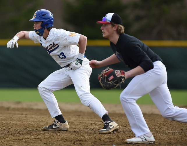 Sophomore Callen Powers (left) and the H-K baseball squad won two of three last week to improve to 3-1 on the year.   File photo by Kelley Fryer/The Source