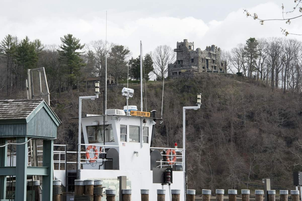 Gillette Castle is seen on the cliffs across the Connecticut River as the Chester-Hadylyme Ferry,  The Selden III, sits at dock on Saturday April 17, 2021.   Wesley Bunnell / Source