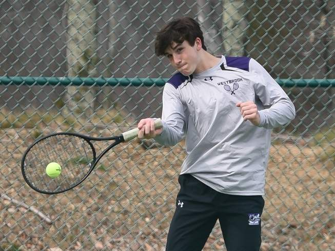 Junior Joey Caslin and the Westbrook boys' tennis team remained perfect on the season at 7-0 after picking up three more wins last week. Caslin claimed a hard-fought 4-6, 6-4, 7-5 victory at the No. 2 singles spot in the Knights' 4-3 victory over Valley Regional on April 23. Photo by Kelley Fryer/Harbor News