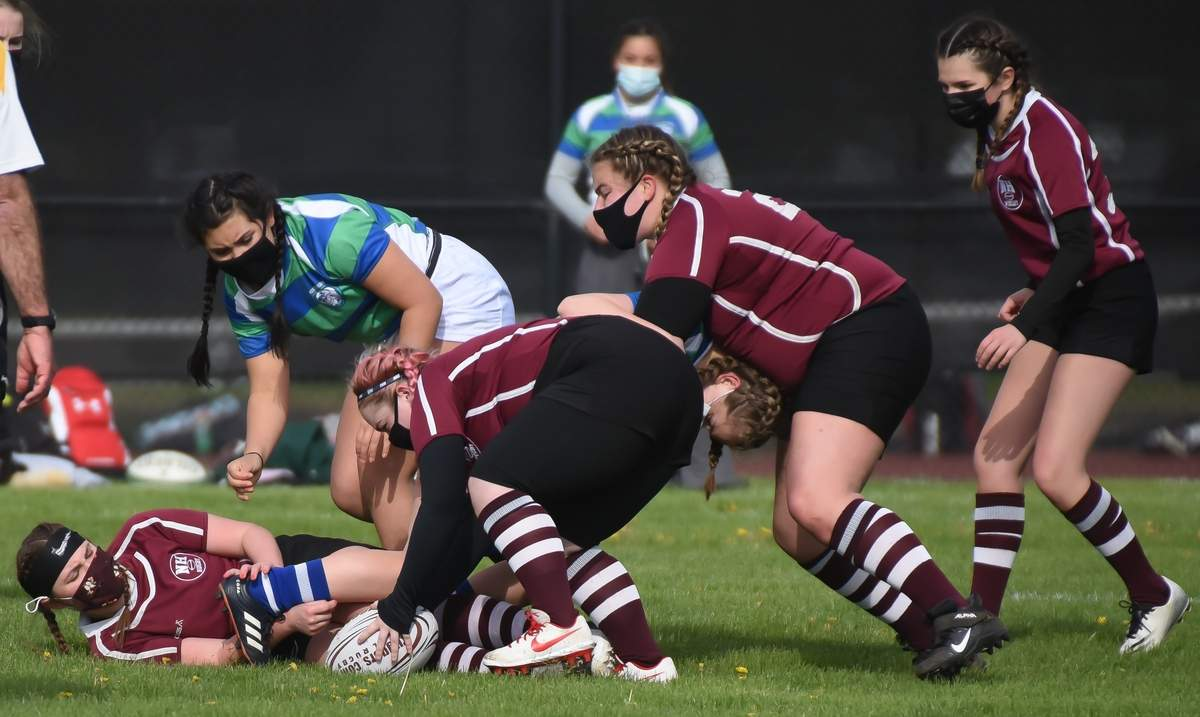 North Haven girls rugby took on MidState at home. Olivia Scoppetto (13), Skylre Hine (9), Nicole Reynolds (20), Gina Peretore (30) Photo by Kelley Fryer/The Courier