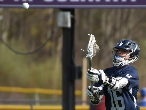 Senior Timothy Lichak and the Morgan boys' lacrosse team claimed two wins last week to move to 3-4 on the season. File photo by Kelley Fryer/Harbor News