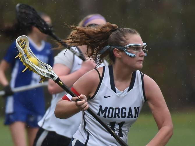 Senior captain attacker Lindsay Narracci and the Morgan girls' lacrosse squad claimed a 10-9 overtime victory against St. Paul Catholic on May 1. Narracci scored five goals in the victory. File photo by Kelley Fryer/Harbor News