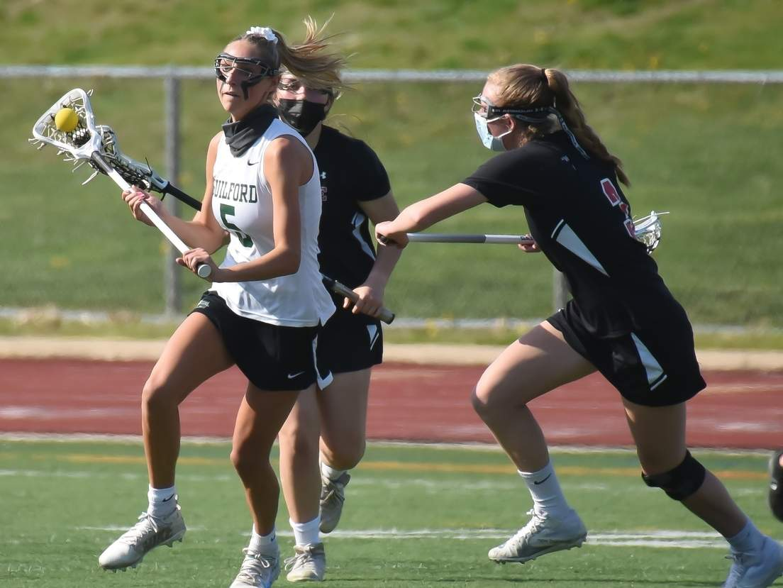 Junior Taylor Farace and the Guilford girls' lacrosse bounced back from a 12-11 loss to Fairfield Ludlowe by claiming a 20-10 victory over Hand to improve to 7-1 on the year. File photo by Kelley Fryer/The Courier