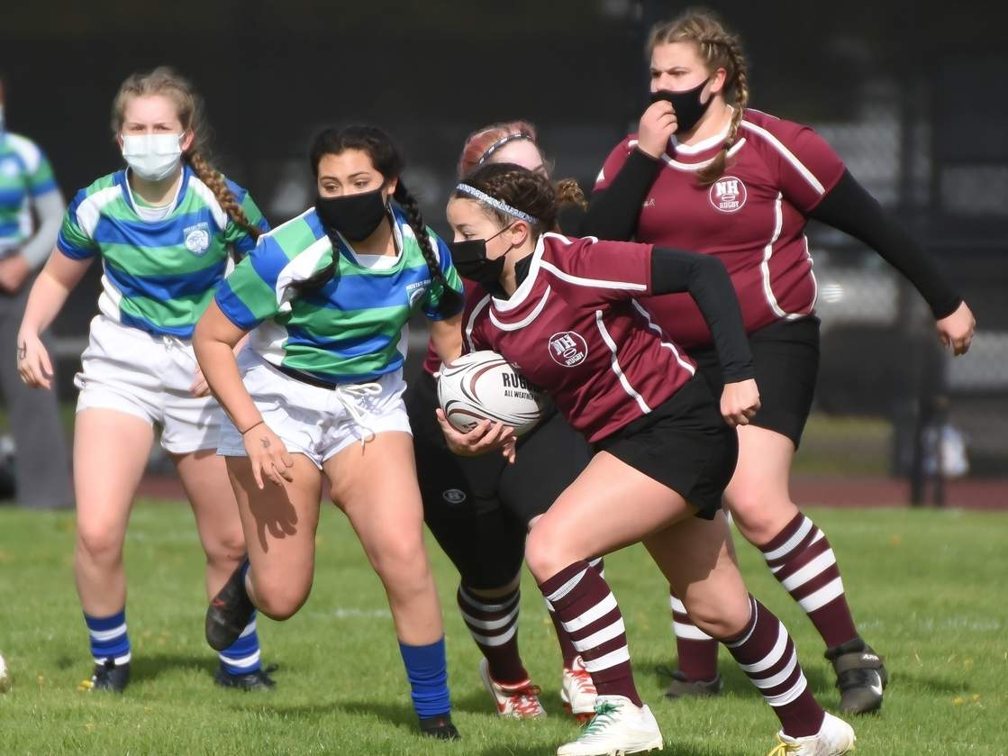 Junior Chandler Ceste-Martinez scored 31 total points to help the North Haven girls' rugby team post three recent wins versus Darien last week, marking the first victories in program history. Also pictured for North Haven is senior captain Nicole Reynolds. File photo by Kelley Fryer/The Courier